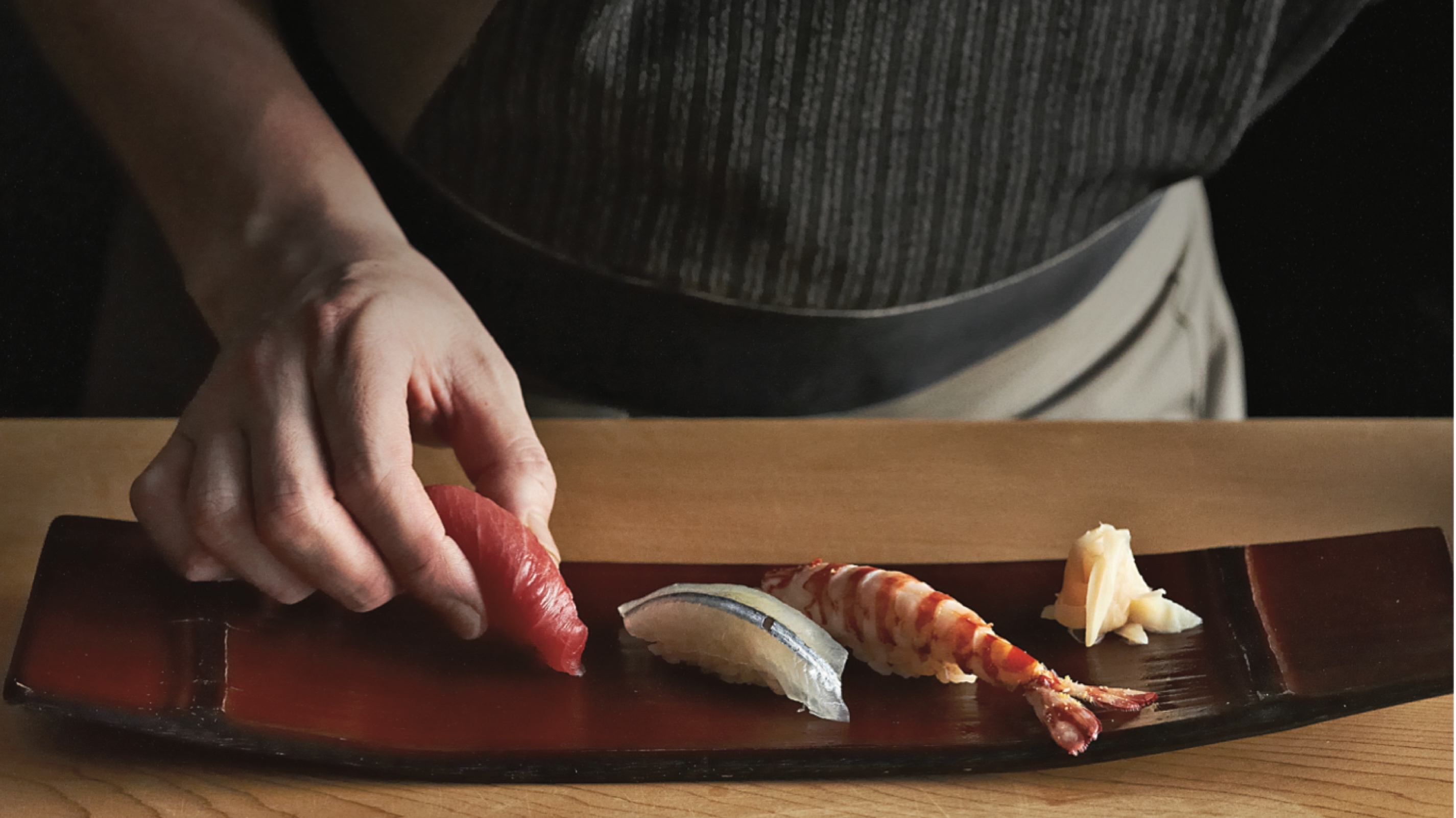 Chef of Sushi SORA Yuji Imaizumi delicately prepared nigiri sushi for diners